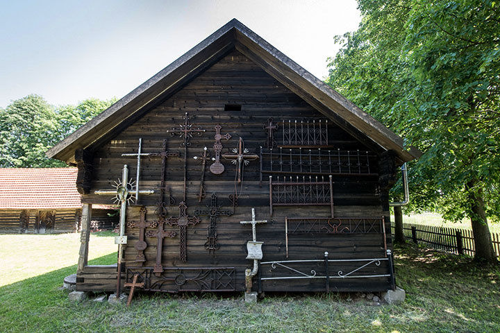 The granary was built in 1921. The external walls of the building are bedecked with crosses and fences from old, rundown graves.